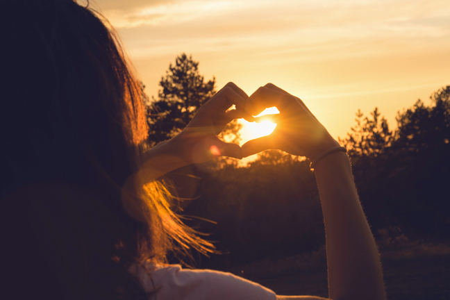 Woman Makes Heart With Hands In Sunset. Healthy People  Lifestyl