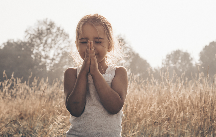Little Girl Closed Her Eyes, Praying Outdoors, Hands Folded In P